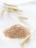 Oat bran. On white kitchen towel Stock Photography