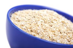 Oat bran. Bowl of oat bran on white background. It is common ingredient of healthy meal Royalty Free Stock Photos