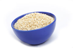 Oat bran. Bowl of oat bran on white background. It is common ingredient of healthy meal stock photos
