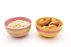 Oat bran and almonds in bowls Stock Images