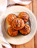 Oat, bran, banana and nut muffins. On plate Stock Photos