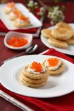 Oat bran cookies with red caviar and cream cheese Royalty Free Stock Photography