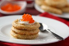 Oat bran cookies with red caviar and cream cheese Royalty Free Stock Photo
