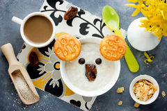 Oat bran porridge with cookies, chocolate and dates shaped cute Royalty Free Stock Photo