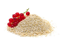 Oat bran with red currants. On a white background Stock Photo