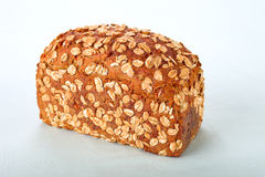 Oat bread. Oat topped whole grain bread Royalty Free Stock Image