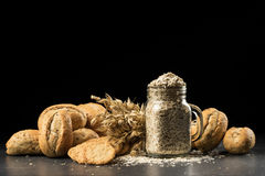 Oat bunch, baked white bread, cookies and flakes in flavouring jar Royalty Free Stock Photography