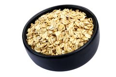 Oat cereal. Bowl of oat cereal on white background. It is common ingredient of healthy meal Royalty Free Stock Photos