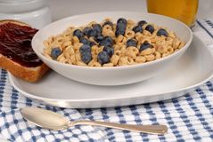 Oat cereal with blueberries, toast with raspberry jam Royalty Free Stock Image