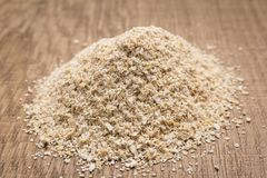 Oat cereal grain. Pile of grains on the wooden table. Selective. Avena Sativa is scientific name of Oat cereal grain. Also known as Aveia or Avena. Pile of Royalty Free Stock Photography