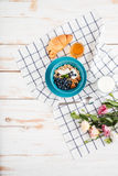 Oat cereals with berries and cream, cup of milk, flowers Royalty Free Stock Photography