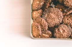 Oat chocolate cookies homemade in metal box on white table Stock Photo