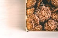 Oat chocolate cookies homemade in metal box on white table Stock Image