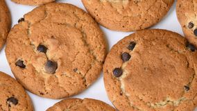 Oat cookies with chocolate pieces rotating. Close-up stock footage