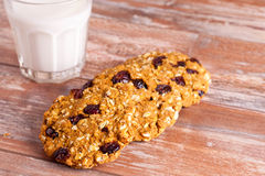 Oat cookies with cranberry and glass of milk. Close up, horizontal Stock Images