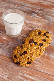 Oat cookies with cranberry and glass of milk. Vertical Royalty Free Stock Photo