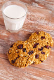 Oat cookies with cranberry and glass of milk. Vertical Royalty Free Stock Images