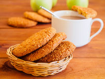 Oat cookies and cup of hot chocolate on wooden table. Shallow depth of field. Royalty Free Stock Photo