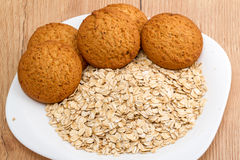Oat cookies and flakes Royalty Free Stock Images