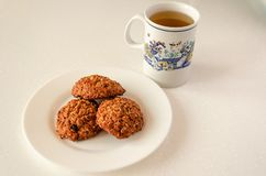 Oat cookies and green tea stock images