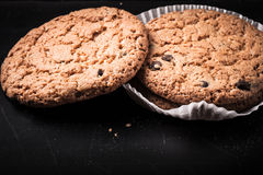 Oat cookies on the old shabby background. tinted Royalty Free Stock Photo
