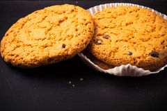 Oat cookies on the old shabby background. tinted Royalty Free Stock Photos