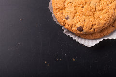 Oat cookies on the old shabby background. tinted Royalty Free Stock Image