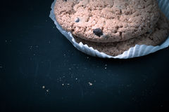 Oat cookies on the old shabby background. tinted Royalty Free Stock Images