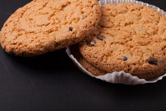 Oat cookies on the old shabby background. tinted. with space for Royalty Free Stock Images