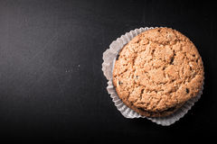 Oat cookies on the old shabby background. tinted. with space for Stock Images