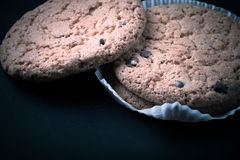 Oat cookies on the old shabby background. tinted. with space for Stock Image
