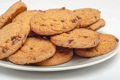 Oat cookies in plate isolated Stock Images