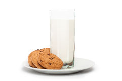Oat cookies in plate and milk in tall glass isolated on white ba Stock Image