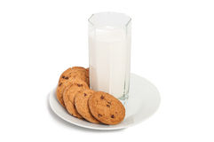Oat cookies in plate and milk in tall glass isolated on white ba Stock Images