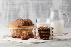 Oat cookies at table with milk Royalty Free Stock Images