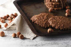 Oat cookies on vintage tray with nuts Stock Photography