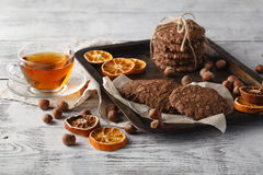 Oat cookies on vintage tray with nuts Stock Image