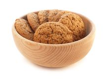 Oat cookies on wooden plate. Oat cookies on the wooden plate against white background Royalty Free Stock Photos