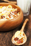 Oat and corn cereal with raisins and peanuts Stock Images
