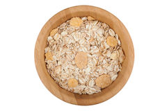 Oat and corn flakes. In wooden bowl isolated on white background Royalty Free Stock Photos