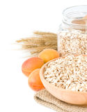 Oat flake cereals on white Stock Image