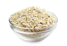 Oat flake in a bowl. Oat flake in a glass bowl on a white background Stock Photos