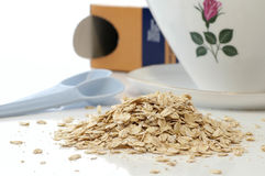 Oat flakes. Stack of oat flakes on the kitchen table Stock Photo
