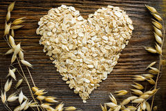 Oat flakes. Heart shape made from oat flakes Stock Photo
