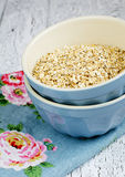 Oat flakes. Bowl of oat flakes on wooden table Stock Photography