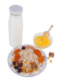Oat flakes. With fruits, honey and milk isolated on a white background Royalty Free Stock Photography