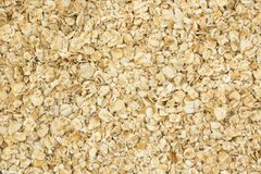 Oat flakes as background. Brown oat flakes as background Stock Images