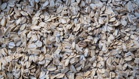 Oat flakes as background. Close-up. Texture. Natural organic food. Healthy dietary food rich in microelements cellulose. Food for vegeterian and people who royalty free stock photos