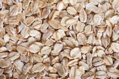 Oat flakes background texture, top view stock image
