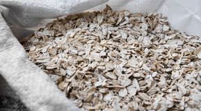 Oat flakes in a bag. Close-up. Texture. Natural organic food. Healthy dietary food rich in microelements cellulose. Food. For vegeterian and people who cares stock photos